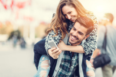 stock-photo-67514965-man-carrying-his-girlfriend-on-piggyback-for-selfie